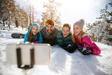family having fun - Mobile photo. Selfie