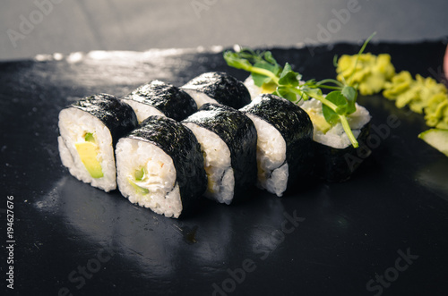 Tuinposter Sushi bar Sushi on dark tile