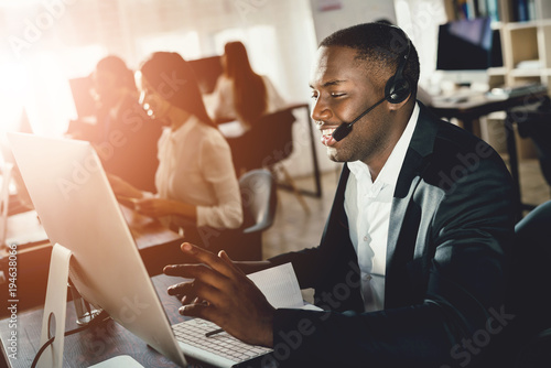A black guy works in a call center.
