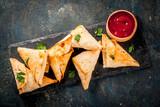 Asian food. Vegetarian samsa (samosas) with tomato sauce. Dark blue background copy space top view - 194647047