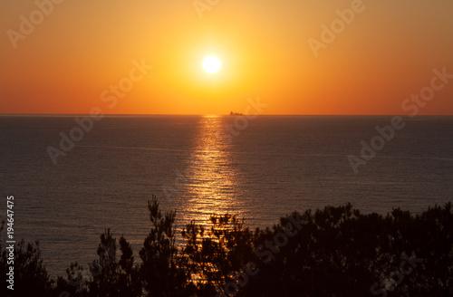 Aluminium Zee zonsondergang Sunset in the north of the island of Ibiza, Spain