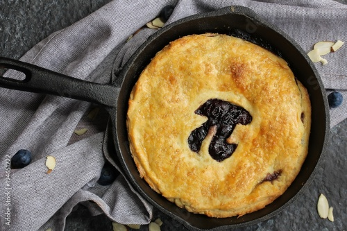 Homemade Skillet  Blueberry Pie with cut out Pi  day writing top down view