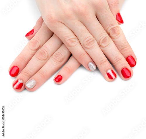 Poster Manicure Female's hands with red manicure on white background.