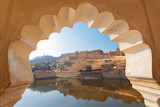 Amer Fort framed within Rajasthani archway architecture  - 194664876