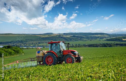 Aluminium Trekker Red tractor and beautiful clouds.