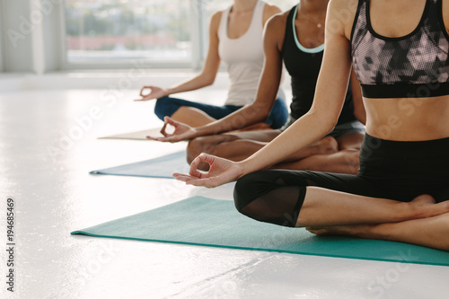 Plakat Females meditating in Padmasana at yoga class