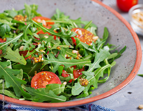 Dietary menu. Vegan cuisine. Healthy salad with arugula, tomatoes and pine nuts. - 194688441