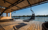 Outdoor hammocks on terrace of house by river - 194691070