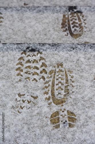Foto op Canvas Stenen hiver gel froid neige climat meteo temperature zero trottoirs pied pas chaussure pieton