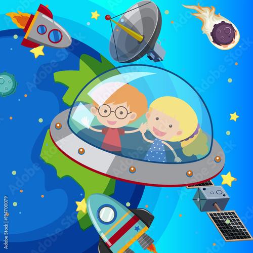 Fototapeta Two kids flying in spaceship