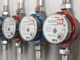 Row of water meters of cold and hot water on the wall background. - 194705222