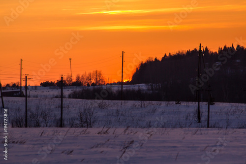 Aluminium Oranje eclat sunset in the winter frosty evening in the Russian outback