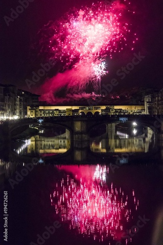 Fotobehang Florence Fireworks by the historic Ponte Vecchio bridge in Florence, for the patron saint day