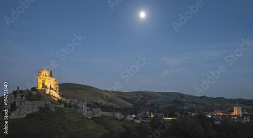 Deurstickers Grijze traf. Lovely Medieval castle landscape during Autumn dusk light with moon