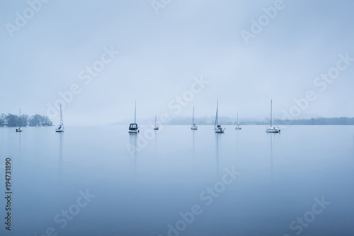 Keuken foto achterwand Blauwe hemel Foggy morning landscape over Lake Windermere in Lake District in Autumn