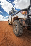 South Australia – Outback desert with 4WD on track under cloudy sky