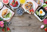 Breakfast food table. Festive brunch set, meal variety with fried egg, pancakes, croissants, smoothie ,fresh berries and fruits. Overhead view - 194750479