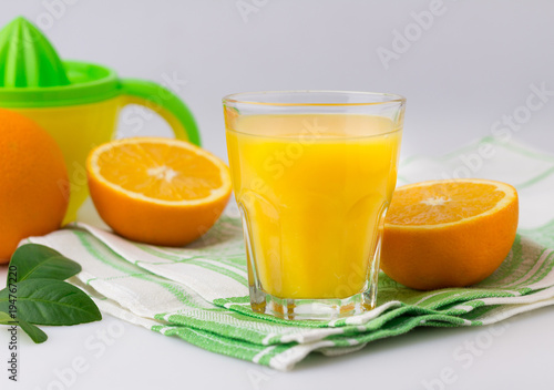 Foto op Canvas Sap Fresh citrus fruit Juice on the white table Citrus press