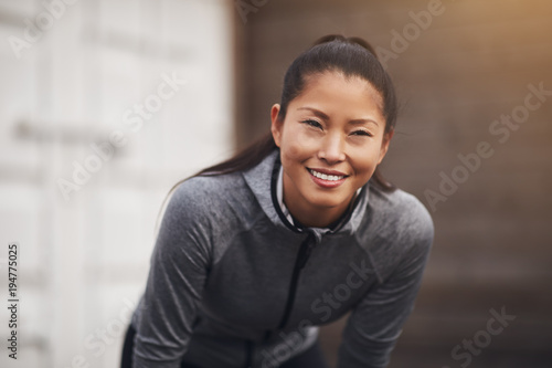 Aluminium Fitness Fit young Asian woman in sportswear out for a run