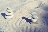 Balanced rocks in zen garden sand circles - 194789494