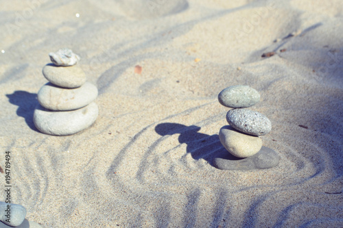 Papiers peints Zen Balanced rocks in zen garden sand circles