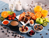 Breakfast served with coffee, juice, croissants and fruits - 194806899