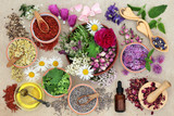 Herbal medicine preparation with herbs and flowers, aromatherapy essential oil bottle and mortar with pestle on hemp paper background. Top view. - 194811224
