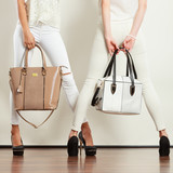 Two slim women in with leather bags handbags. - 194816051