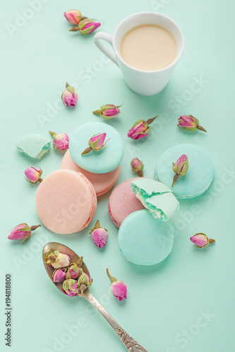 Coffee cup and colorful macaron on pastel  background top view Poster