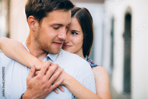 Young couple in love huggin on street