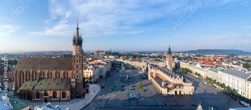 Fotobehang Krakau Aerial panorama of Krakow old city, Poland. Main Market Square (Rynek), old cloth hall (Sukiennice), town hall tower, St. Mary church (Mariacki), renovated Mickiewicz statue and far view of Wawel