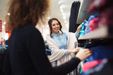 Two young girls look at clothing in store - 194823215