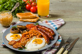 Full English breakfast, with sausage, mushrooms, beans and a fried egg. - 194828808
