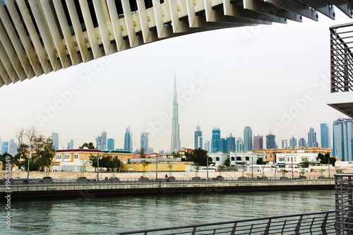 Tuinposter Dubai Dubai Water canal footbridge and city panorama in the background