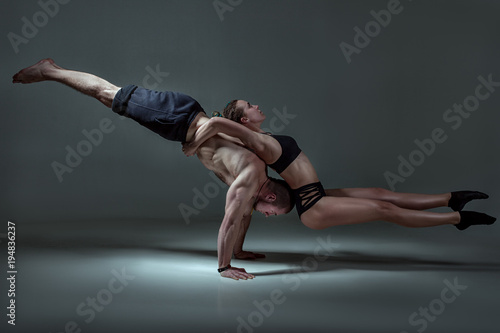 Gymnastic show, a young couple shows performance from their bodies.
