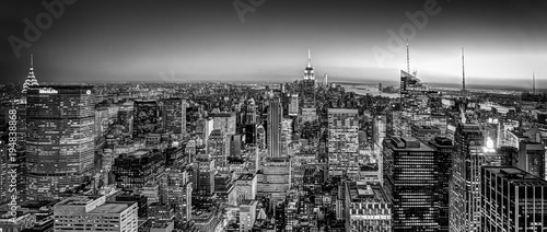 New York City. Manhattan downtown skyline with illuminated Empire State Building and skyscrapers at dusk. USA. Black and white image.