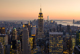 Golden sunset panoramic view of building and skyscrapers in Midtown and downtown skyline of lower Manhattan, New York City, USA.