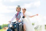 Wedding groom and bride driving motor scooter having fun  - 194841225