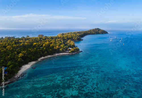 Deurstickers Tropical strand Aerial view of tropical island with Sandy beach, palm, coconut among clear ocean. This aerial view from Lipe Island, beautiful beach and island in south of Thailand. Blue ocean with coral.
