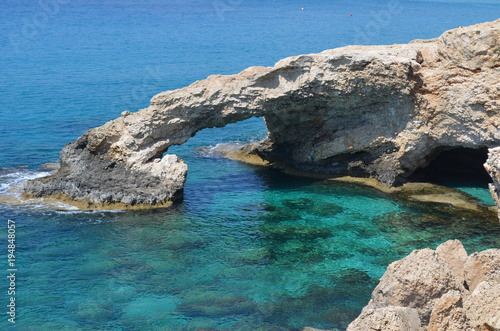 In de dag Cyprus Love Bridge - beautiful natural rock arch near Ayia Napa, Cavo Greco and Protaras on Cyprus Island, Mediterranean Sea.