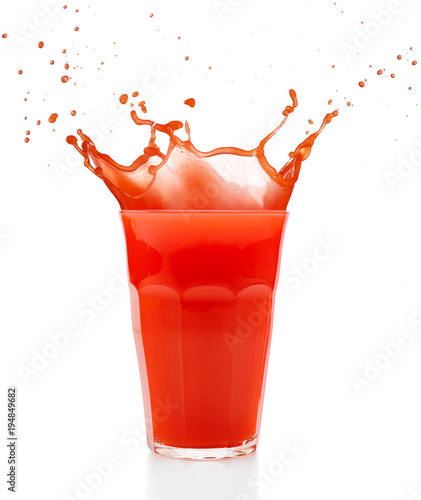 Foto op Canvas Sap red juice splashing out of a glass isolated on white
