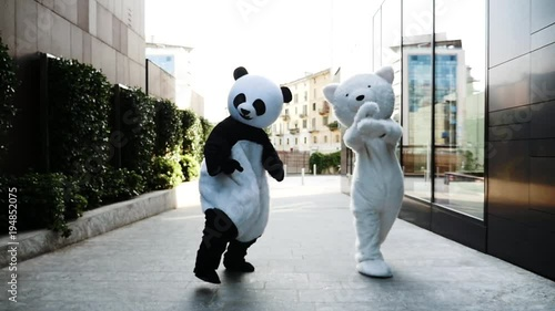 Panda and teddy bear around in the city