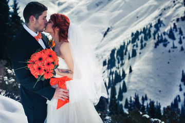 Wedding snowboarders couple just married at mountain winter