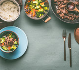 Healthy balanced nutrition food with beef meat, steamed vegetables and rice on table background with plate and cutlery, top view, frame with copy space - 194857624
