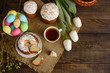 Easter cake and colorful eggs on a wooden table. It can be used as a background - 194861499