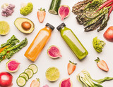 Green and yellow smoothie bottles with organic fruits and vegetables ingredients on white desk background, top view, flat lay. Healthy clean and detox, weight loss dieting or fasting  food concept - 194867671