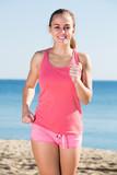 female jogging at sea beach