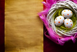 Three white Easter eggs in the nest and blank handmade paper sheet - 194876408