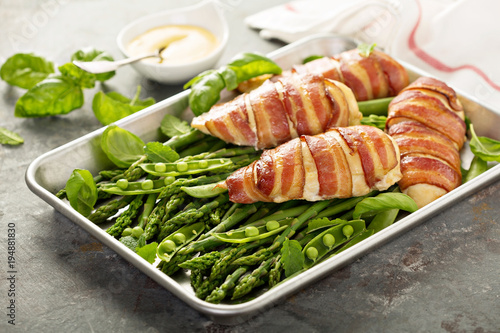 Bacon wrapped chicken breast with asparagus - 194881830