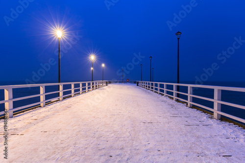Fotobehang Donkerblauw Snowy pier at Baltic Sea in Gdansk, Poland